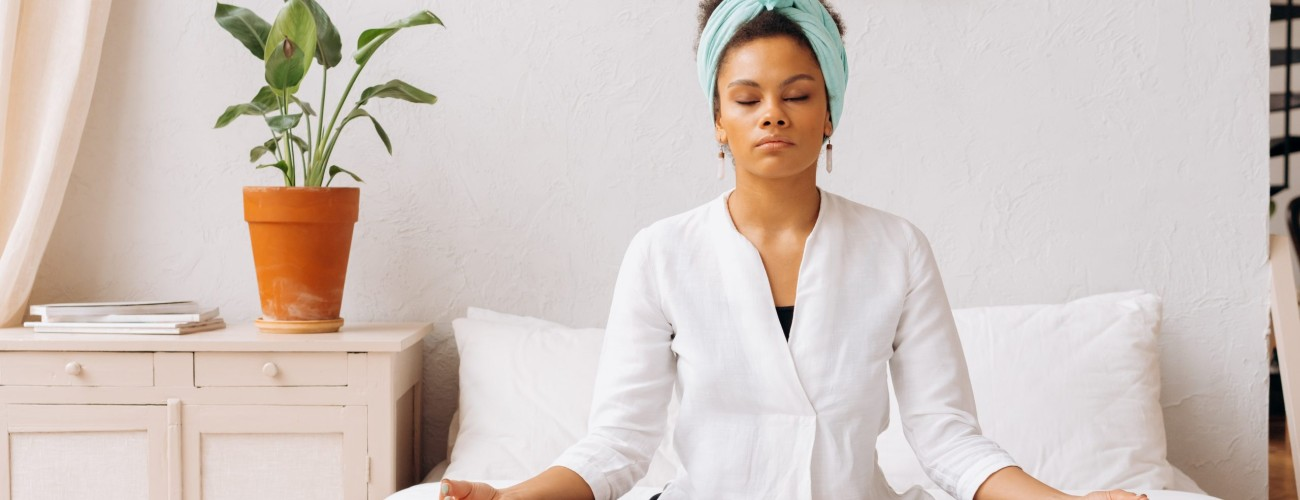 5 Yoga Poses You Can Do At Your Desk Or In Bed To Better Your Posture